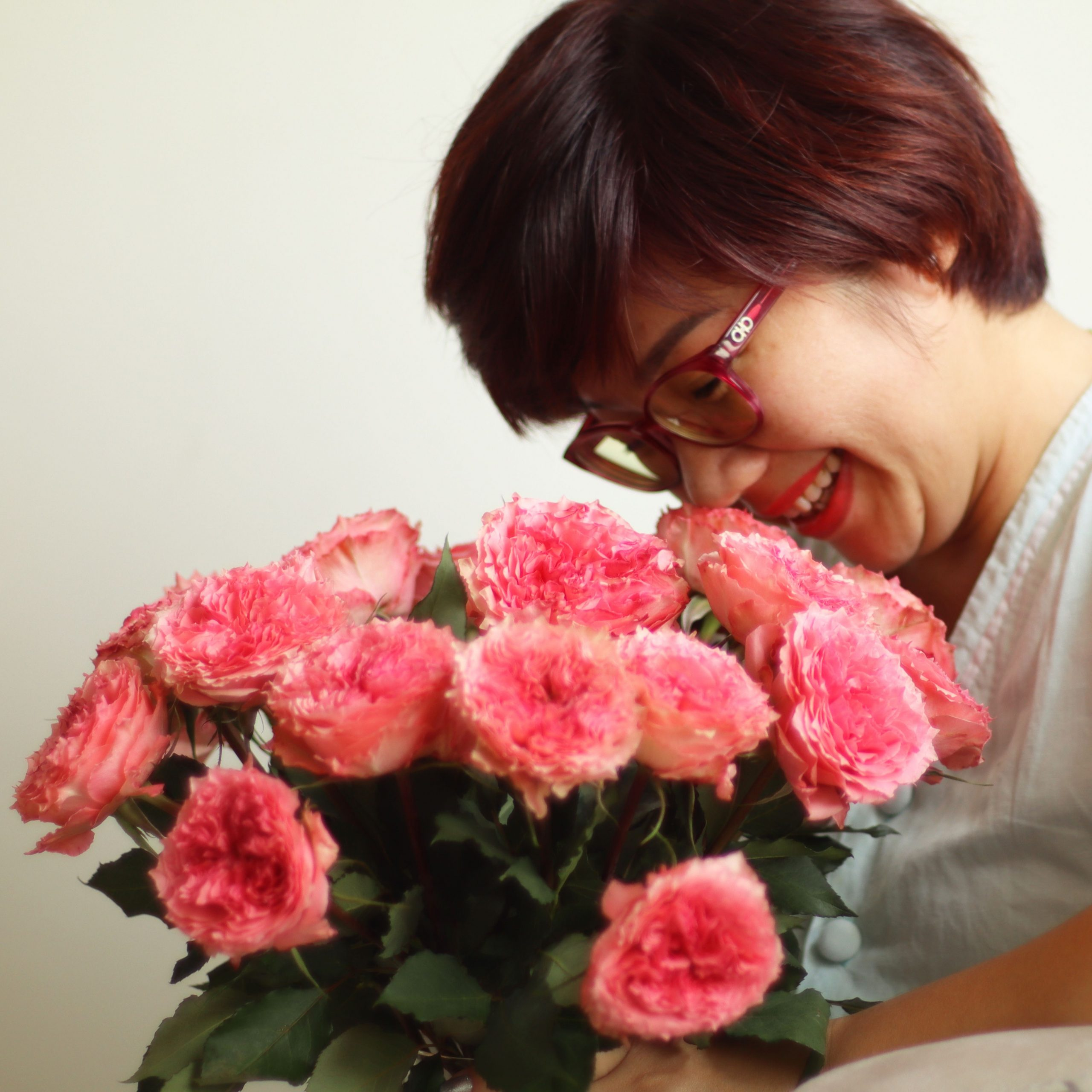 woman happily receiving flowers